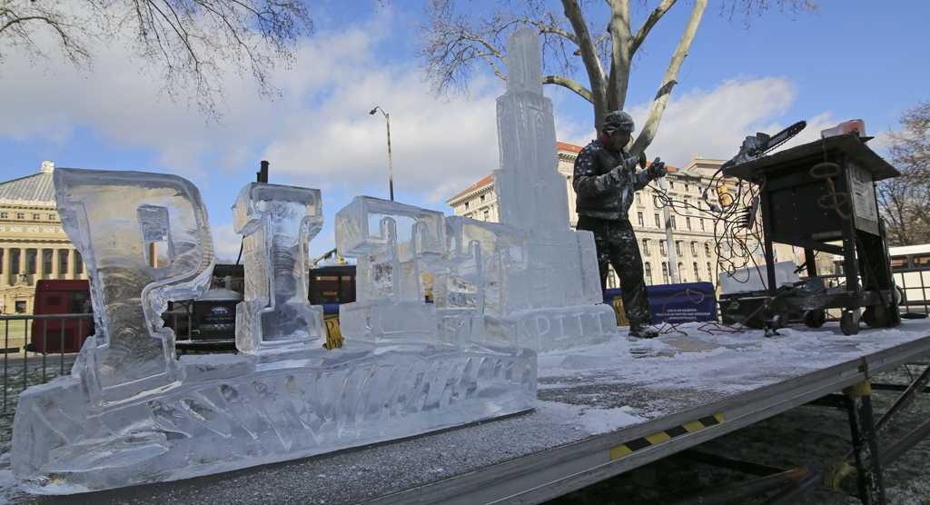Richard Bubin, owner of Ice Creations, carved the Cathedral of Learning and other sculptures out of a block of ice in front of the William Pitt Union on Monday.  Theo  Schwartz | Senior Staff Photographer.