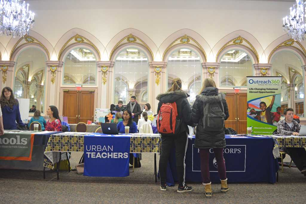 Students gather around tables in the William Pitt Union on Wednesday to learn about and sign up for volunteer activities during a PittServes volunteer fair.  Valkyrie Speaker | Staff Photographer