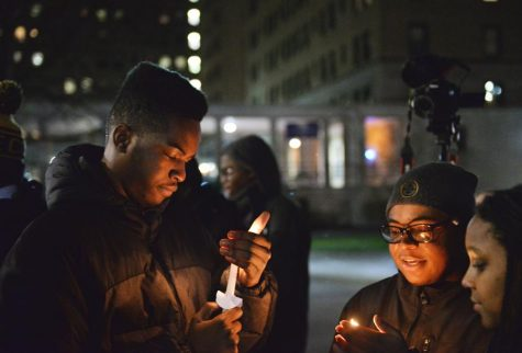 Alpha Phi Alpha held a vigil Monday night outside of the William Pitt Union. John Hamilton | Staff Photographer