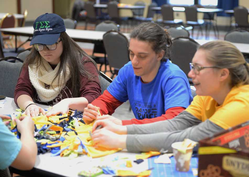 Students assemble knot rugs as part of the MLK Day of Service hosted by PittServes.  William Miller | Staff Photographer