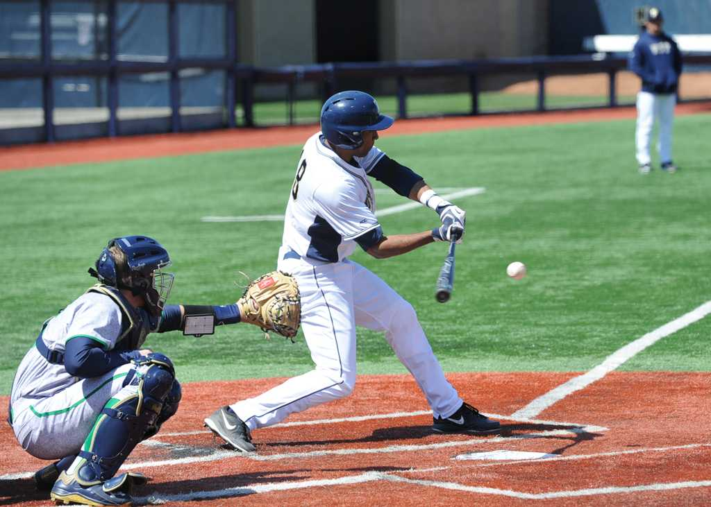 Ron Sherman (18) takes a swing at a pitch in a game last year.  Pitt New File Photo