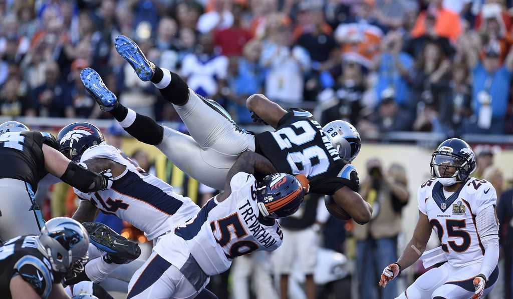 Carolina Panthers running back Jonathan Stewart (28) scores a touchdown as he leaps over Denver Broncos linebacker Danny Trevathan (59) in Super Bowl 50. (TNS)