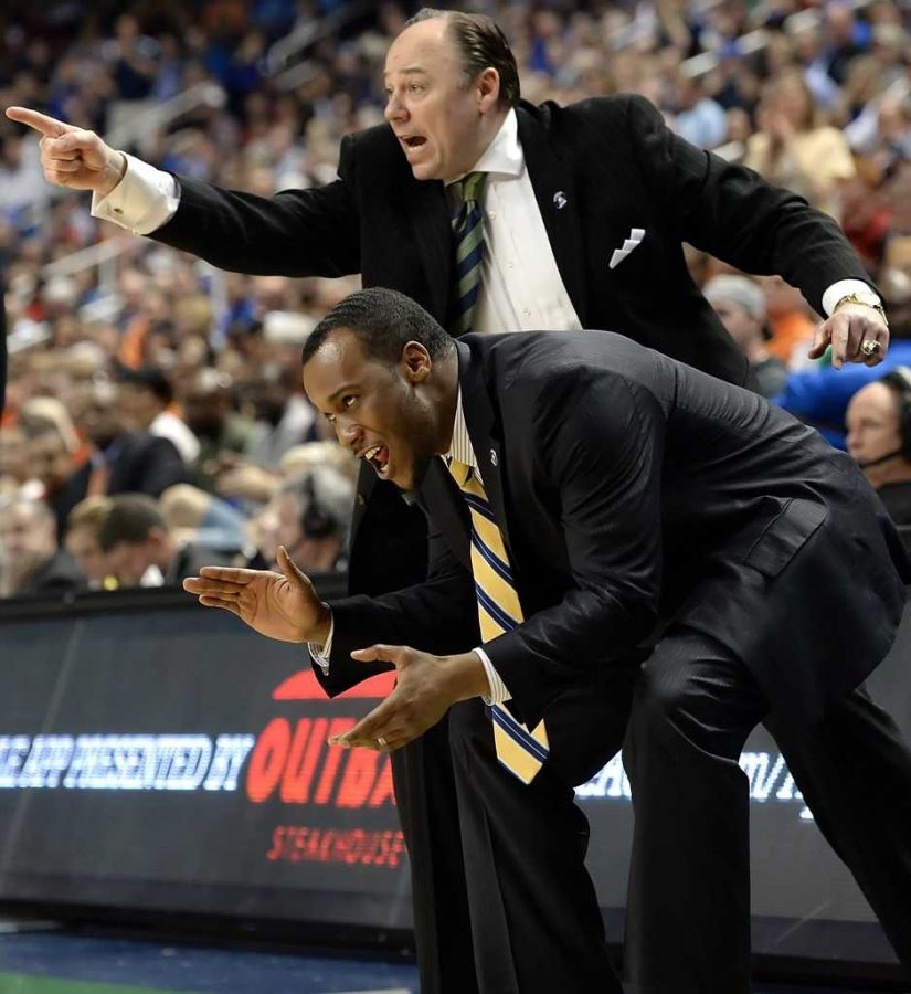 Pittsburgh assistant coaches Barry Rohrssen and Brandin Knight call out to their team as they take on Virginia in the second half of the semifinals of the ACC Tournament in Greensboro, N.C., Saturday, March 15, 2014. Virginia defeated Pitt, 51-48. (Matt Freed/Pittsburgh Post-Gazette/MCT)