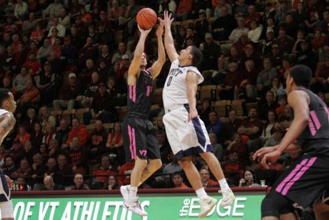 James Robinson (0) jumps for the ball at Cassell Coliseum on March 2, 2016 (Courtesy of  Cat Piper / Collegiate Times).