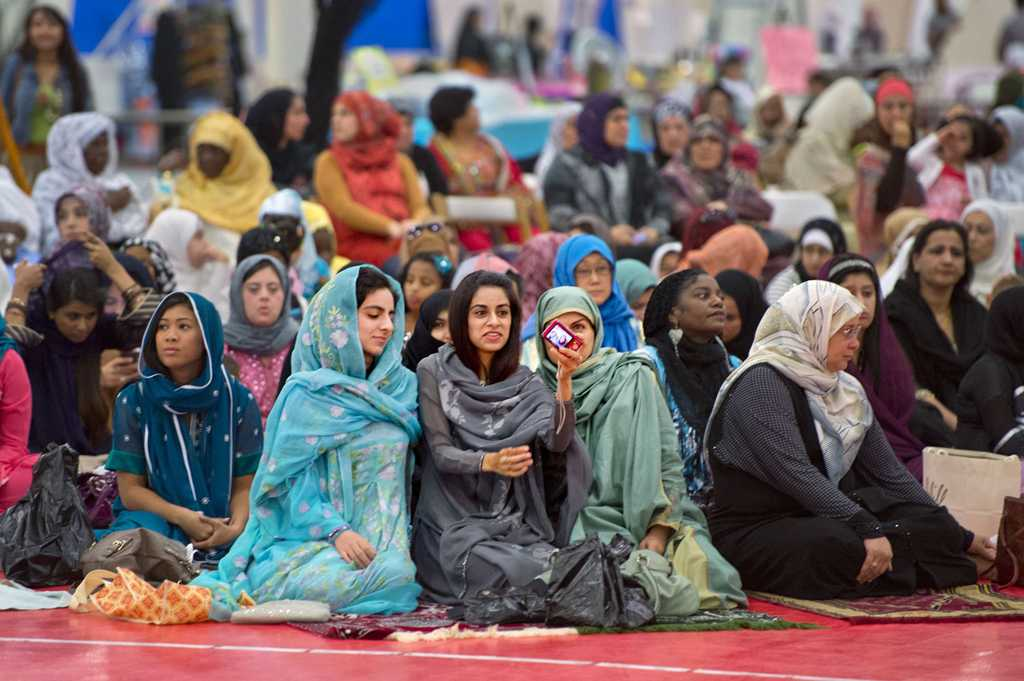 Women look at a picture they took of themselves before the start of the Eid prayer, marking the end of Ramadan, the Muslim month-long fasting ritual as more than 3,500 gathered inside the Jackson Sports Academy at McClellan Park on Thursday, August 8, 2013, in Sacramento, California. Eid celebrates the conclusion of the dawn-to-sunset fasting during the month of Ramadan. (Randy Pench/Sacramento Bee/MCT)