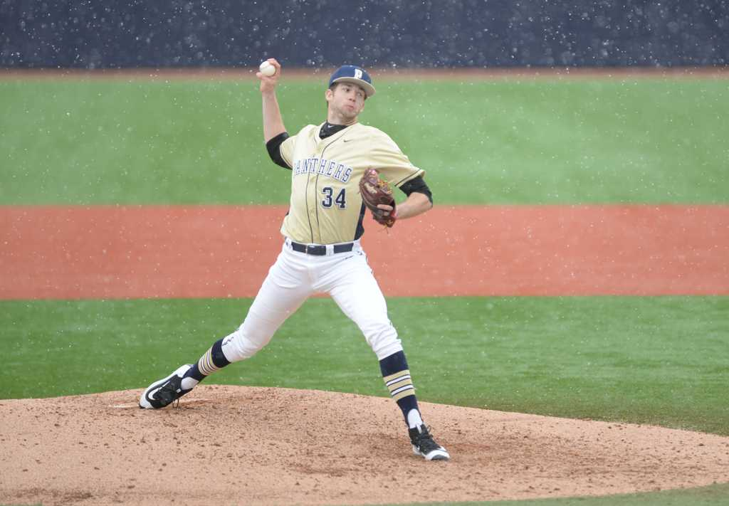 TJ Zeuch pitches in a snowy game vs. Florida State Sunday afternoon.  Jordan Mondell | Staff Photographer