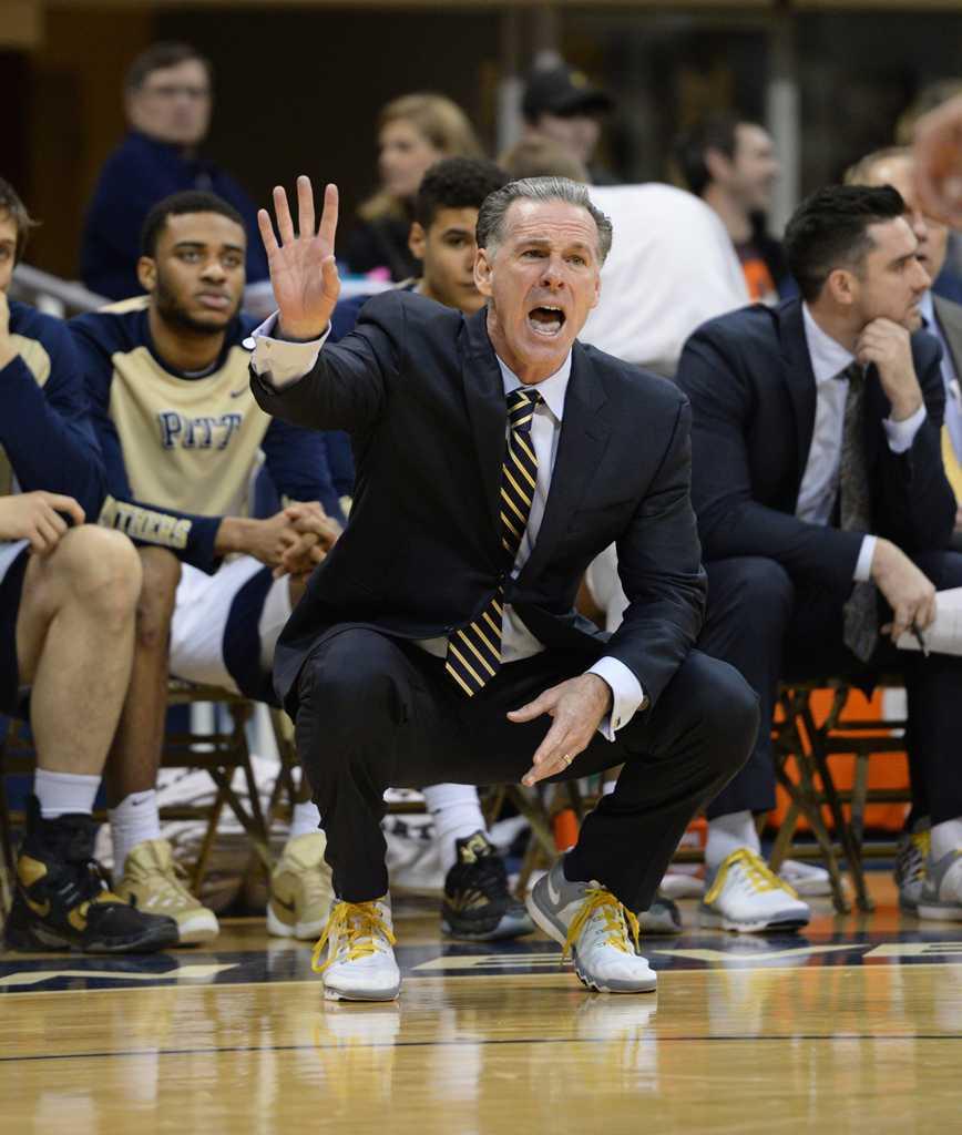 Pitt Men's Basketball Coach, Jamie Dixon, signals to players from the sideline. John Hamilton | Staff Photographer