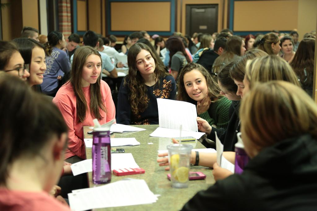 Students work on a group activity at the ZBT and SDT Safe Smart Dating event.  Nikki Moriello | Senior Staff Photographer