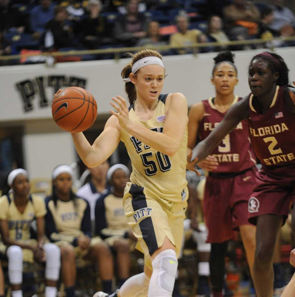 Brenna Wise dribbles past Florida State defenders.  Jeff Ahearn | Assistant Visual Editor