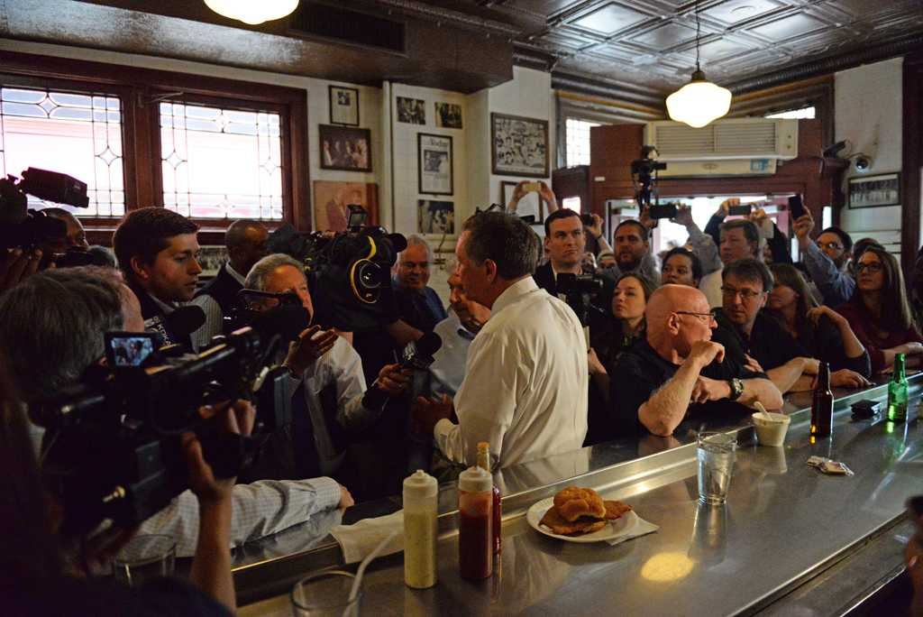 Governor Kasich views the pictures in the Original Oyster House in Market Square. Alex Nally | Staff Photographer
