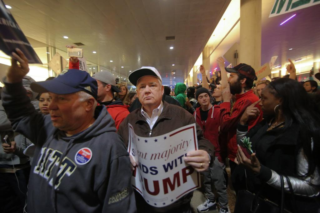 Trump supporter exits the David Lawrence Convention Center amidst protesters and other supporters on April 14, 2016. Theo Schwarz | Senior Staff Photographer