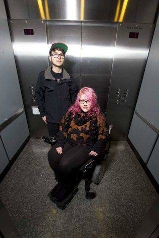 Monica Silny and her aide, Blake Hubert, in the elevator she uses to get to her dorm from the Petersen Events Center. Theo Schwarz | Senior Staff Photographer