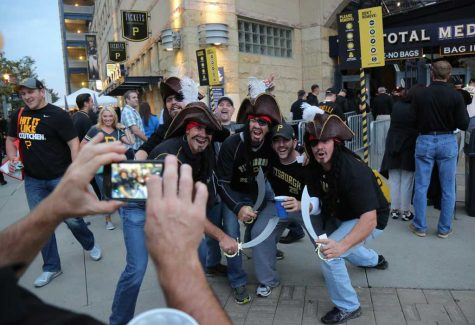 Pirates fans pose for a picture.  Theo Schwarz | Senior Staff Photographer