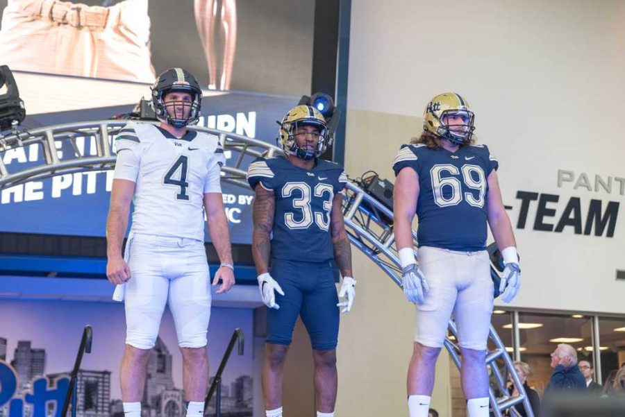 Nathan+Peterman+%284%29%2C+Jordan+Whitehead+%2833%29+and+Adam+Bisnowaty+%2869%29+show+off+the+new+Pitt+football+uniforms.+Matt+Hawley+%7C+Staff+Photographer