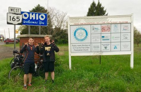 Max Lindsay and Zach Ward take a picture in front of the Ohio state sign. / Courtesy of Malcolm Juring