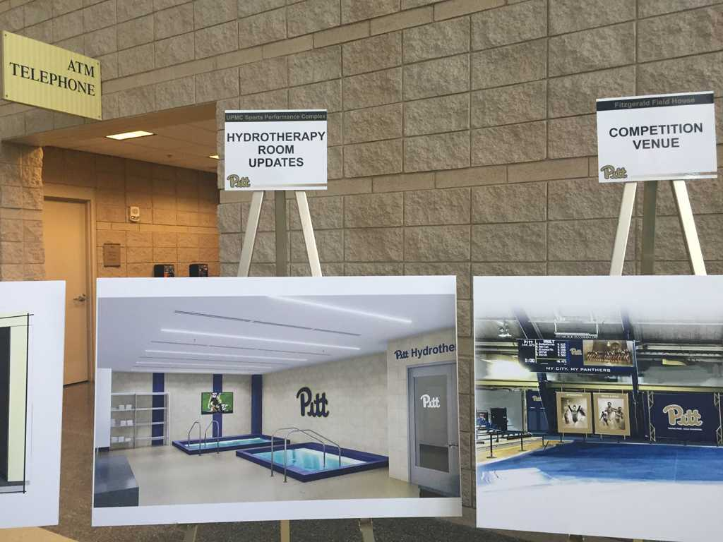 Posters previewing the athletic facility renovations. Photo by Meg Millure