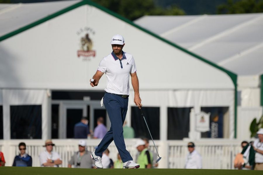 Dustin+Johnson+acknowledges+the+crowd+after+making+a+putt+on+the+17th+green+Sunday+morning.+Jeff+Ahearn+%7C+Senior+Staff+Photographer