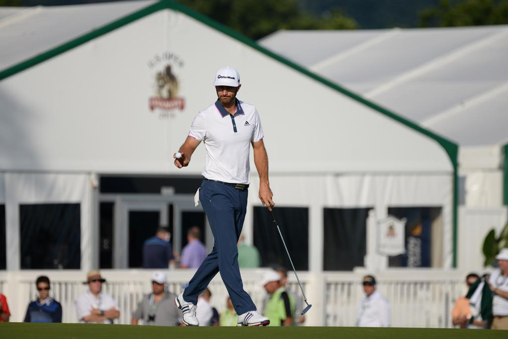 Dustin Johnson acknowledges the crowd after making a putt on the 17th green Sunday morning. Jeff Ahearn | Senior Staff Photographer