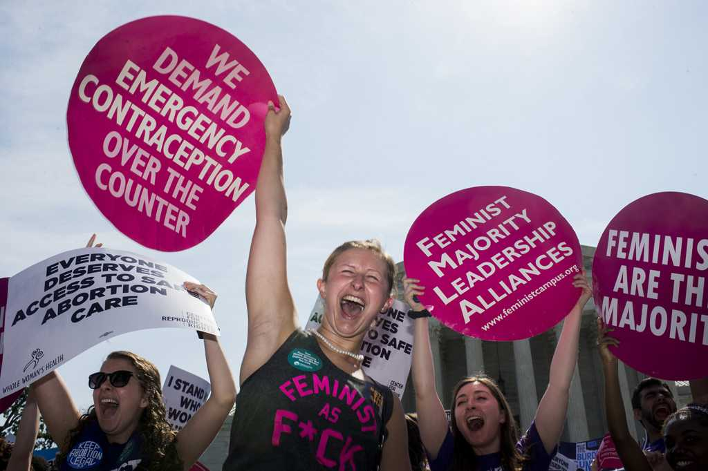 Pro-choice demonstrators at the U.S. Supreme Court cheer as they learn the court struck down the Texas abortion law on Monday, June 27, 2016 in Washington, D.C. (Bill Clark/Congressional Quarterly/Newscom/Zuma Press/TNS)