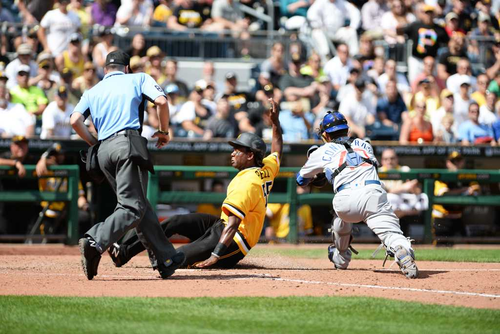 Rookie first baseman Josh Bell slides safely into home plate on Sunday afternoon. Matt Hawley | Staff Photographer