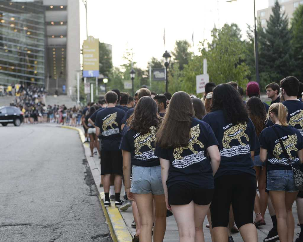 Pitt+first-years+climb+Cardiac+Hill+to+the+Petersen+Event+Center+Tuesday+evening+for+their+class+picture.+Stephen+Caruso+%2F+Senior+Staff+Photographer