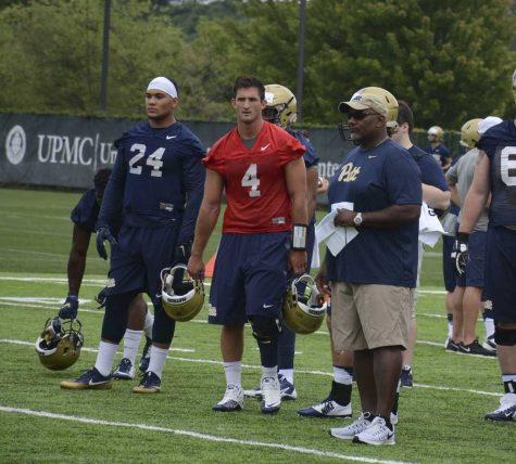 Andre Powell, far right, is both Pitt's special teams and running backs coach. Stephen Caruso / Visual Editor