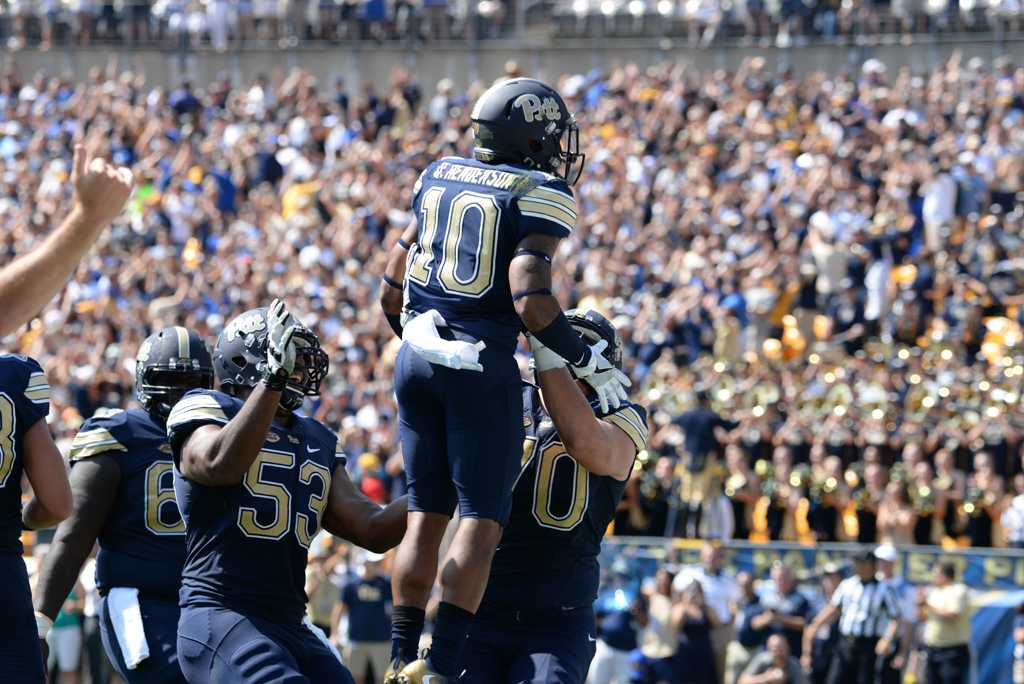 Wide receiver Quadree Henderson (10) and teammates celebrate a first-quarter touchdown against Penn State. Jeff Ahearn | Senior Staff Photographer