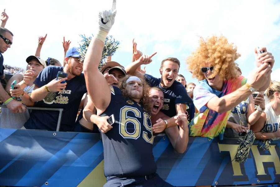 Adam+Bisnowaty+celebrates+with+Pitt+students+after+the+team%27s+42-39+win+over+Penn+State+on+Sept.+10.+Jeff+Ahearn+%7C+Senior+Staff+Photographer