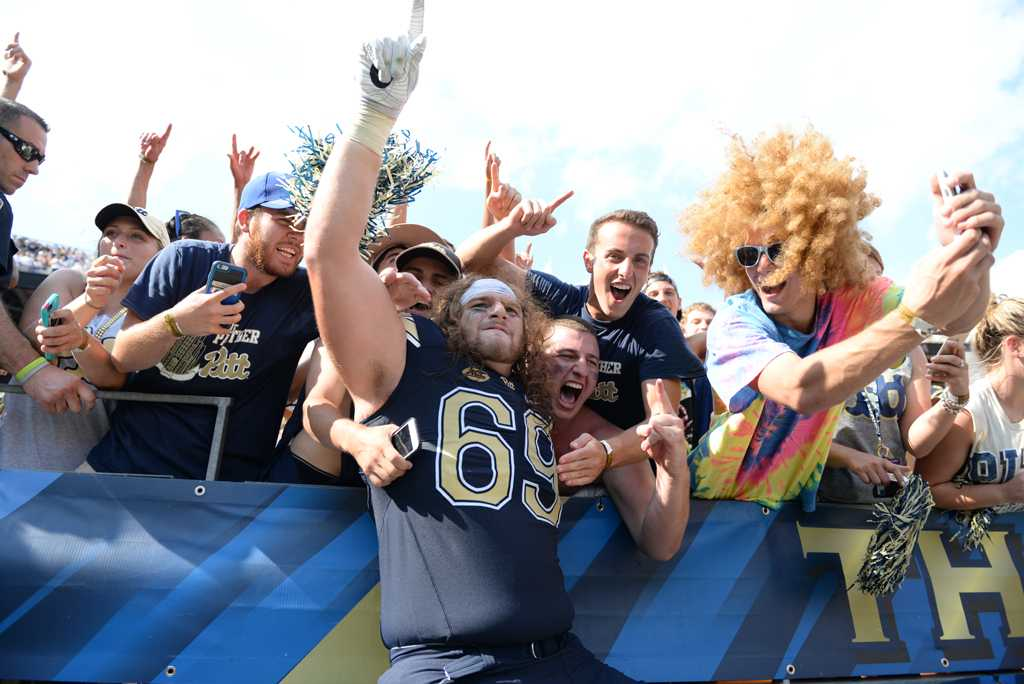 Adam Bisnowaty celebrates with Pitt students after the team's 42-39 win over Penn State on Sept. 10. Jeff Ahearn | Senior Staff Photographer