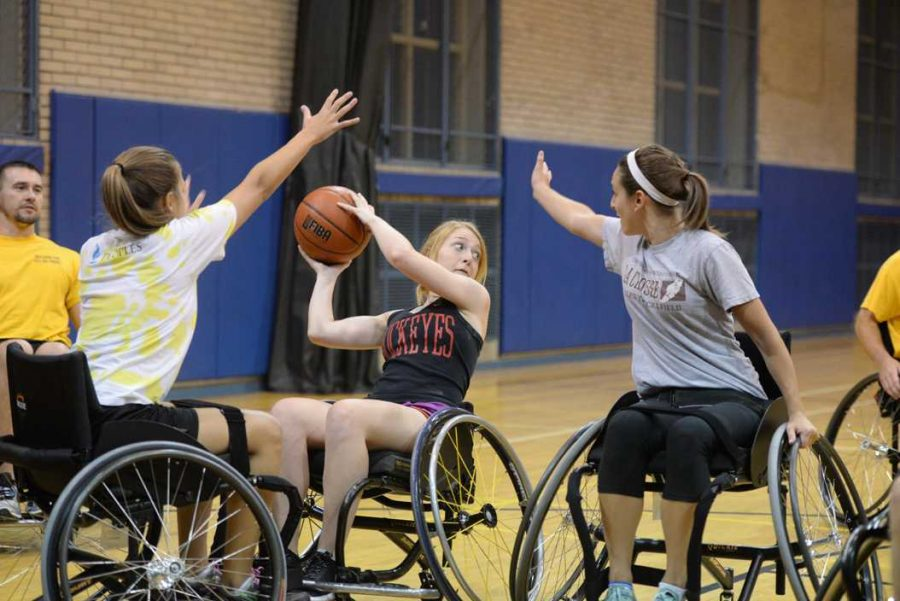 Lainey+Elliot%2C+Kelley+Schpech%2C+and+Jessica+Krausenick+participate+in+a+five-on-five+game+of+wheelchair+basketball+in+the+Bellefield+Gym+Thursday+evening.+Theo+Schwarz+%7C+Senior+Staff+Photographer
