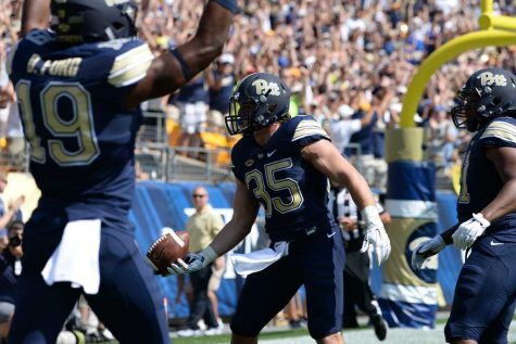 Pitt fullback George Aston celebrates after scoring a touchdown. Jeff Ahearn | Senior Staff Photographer