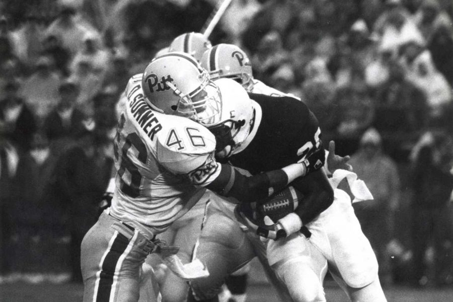 Pitt+defensive+back+David+Sumner+smashes+into+a+Penn+State+ball+carrier+in+the+1992+game.+Pitt+News+file+photo.