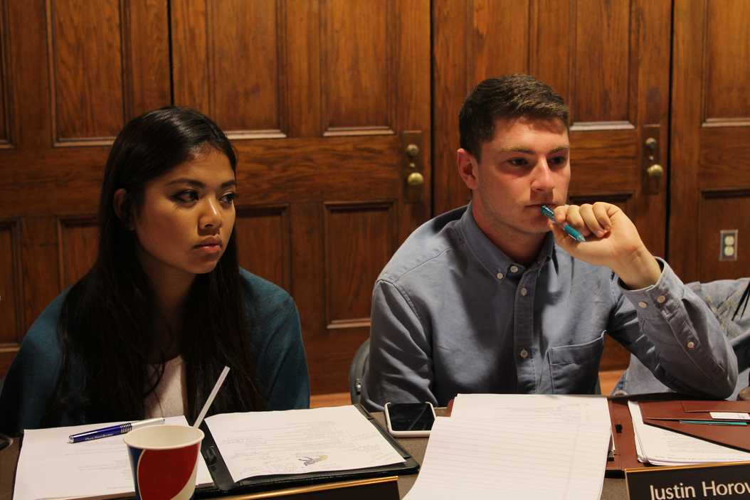 Justin Horowitz and Alyssa Laguerta listen to audience members intently during Tuesday night's weekly meeting. Katie Krater | Staff Photographer