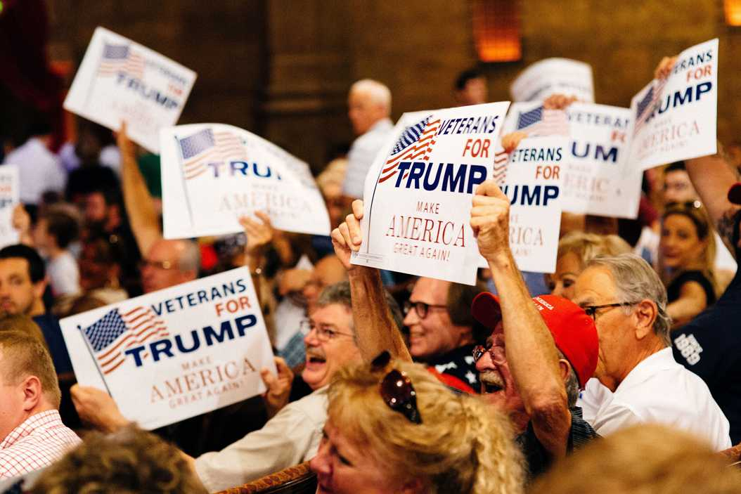 Supporters of Donald Trump wave their campaign signs during Trump's June 15, 2016, rally in Atlanta, Ga. (Annalise Kaylor/NurPhoto/Sipa USA/TNS)