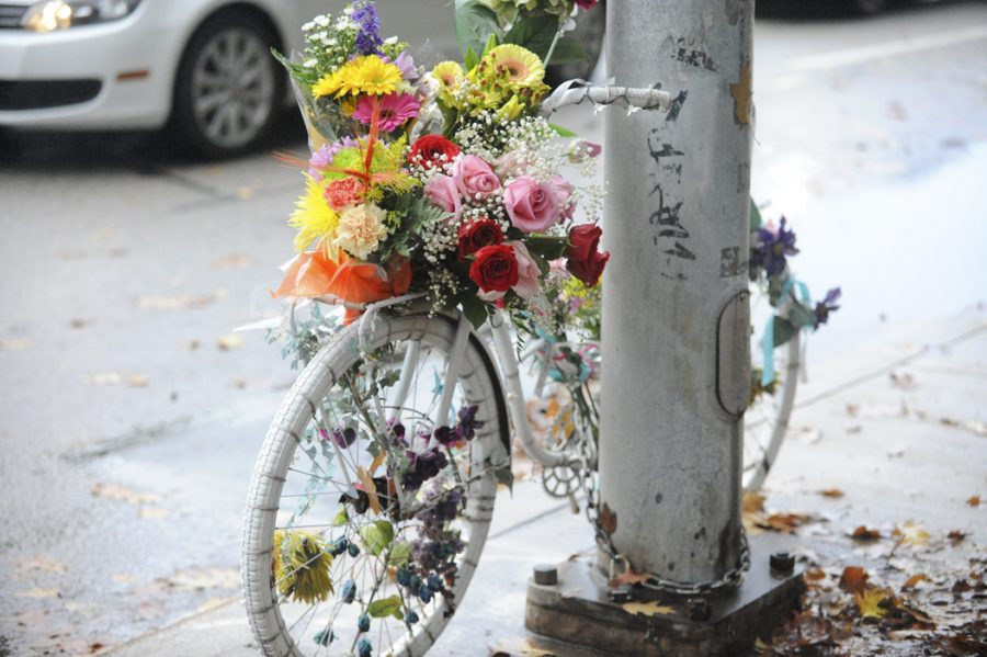 Bikers+and+pedestrians+decorated+Susan+Hicks%E2%80%99s+ghost+bike+at+the+intersection+of+Bellefield+and+Forbes+avenues+commemorating+the+professor%2C+who+was+killed+there+last+year.+Kyleen+Considine+%7C+Staff+Photographer
