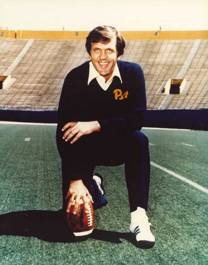 Former+Head+Football+Coach+Jackie+Sherrill+crouches+sporting+Pitt+script+and+colors.+Courtesy+of+University+Library+Systems