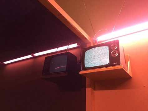 A TV plays static on an upper wall. Lexi Kennell | Staff Photographer