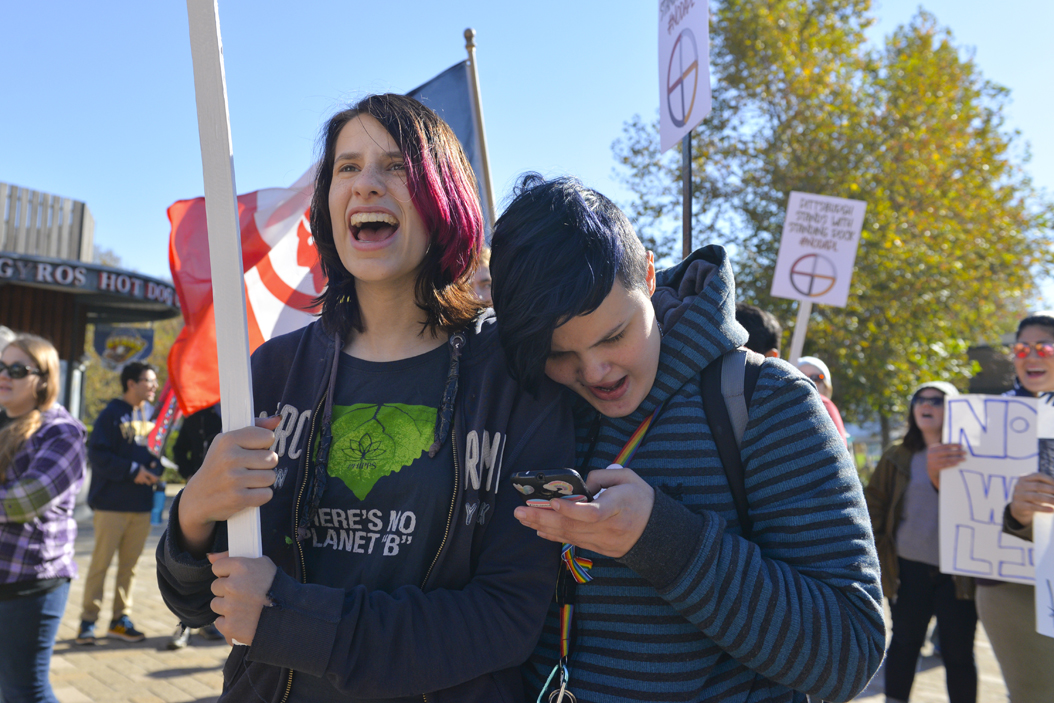 """Jimmy Coblin, (left) in high school, and Riley Duncan, (right) a Job Corps member, chant, """"What do we want? Clean water. When do we want it? Now,"""" against the Dakota Access Pipeline in Schenley Plaza late Saturday morning. Stephen Caruso   Senior Staff Photographer"""