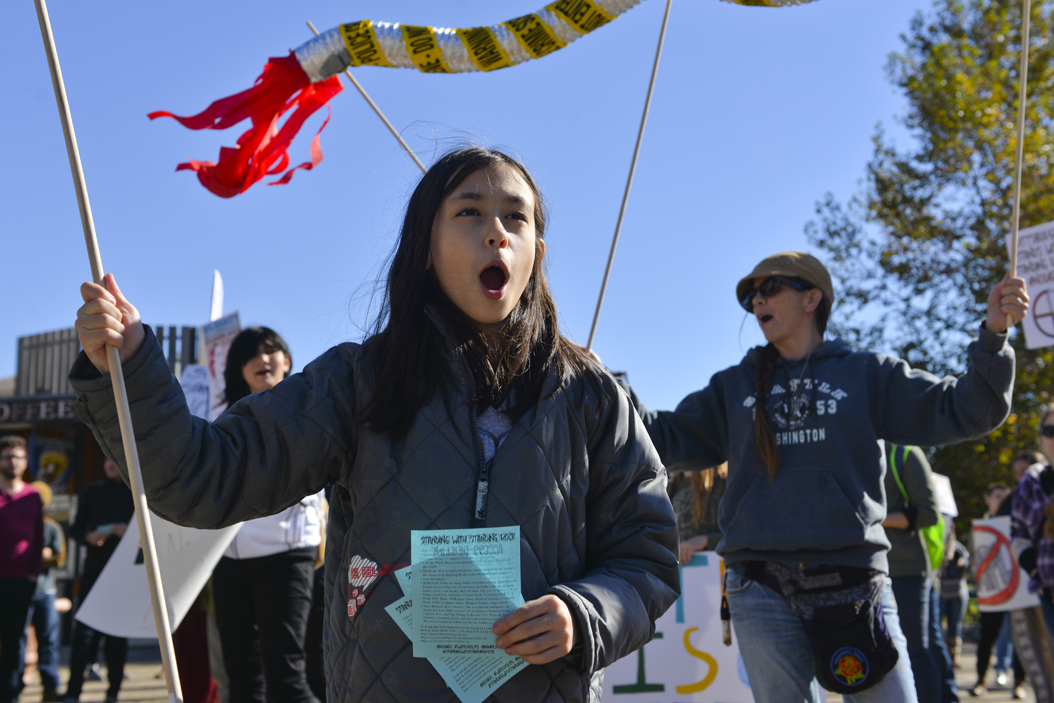 "Raven Dean, age 9, came to the protest with her father, Chuck Dean, to publicize the Dakota Access Pipeline because ""the government is trying to hide [it]."" Stephen Caruso 