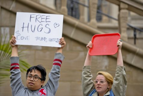 "About 15 students offered ""free hugs"" outside the Cathedral. Kyleen Considine 