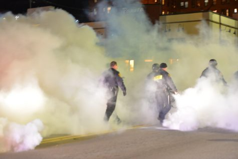 At an East Liberty protest, police used a smoke bomb to clear the streets. Rachel Glasser | Staff Photographer