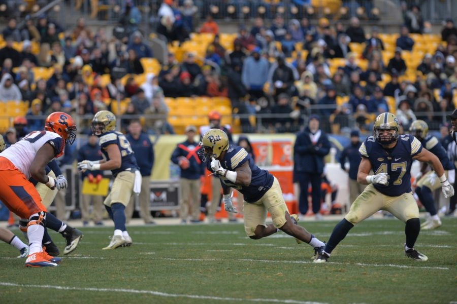Pitt defensive end Ejuan Price (5) and linebacker Matt Galambos (47) each played the final home game of their college careers at Heinz Field Saturday. Steve Rotstein | Contributing Editor
