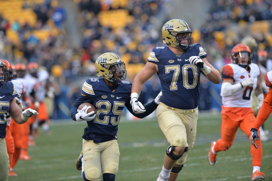Pitt OL Brian O'Neill (70) helps pave the way to the end zone for Maurice Ffrench. Steve Rotstein | Contributing Editor
