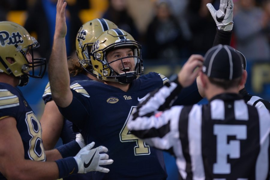 Pitt QB Nathan Peterman signals for a touchdown after a 43-yard run. Referees initially ruled the play a touchdown, then ruled Peterman out of bounds at the 1-yard line after a review. Steve Rotstein | Contributing Editor
