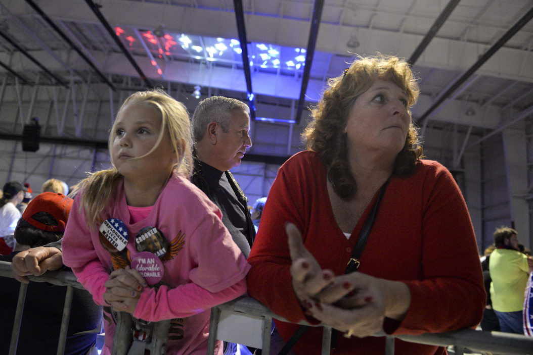 Wendy Twiss and her daughter Kara look into the media pen as they wait for Trump to arrive. John Hamilton | Senior Staff Photographer