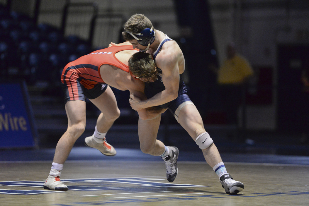 Dom Forys, along with wrestlers Jake Wentzel and TeShan Campbell, won two matches at the season opening tournament this weekend. Meghan Sunners | Senior Staff Photographer