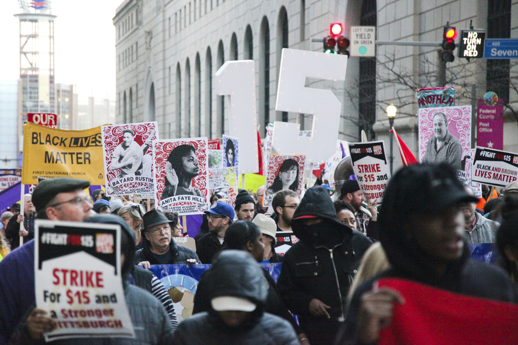 Hundreds of people gathered downtown on Tuesday to protest for a $15 minimum wage, among other social issues | Julia Zhu, Staff Photographer
