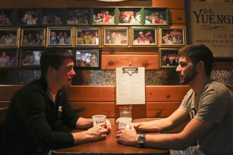Connor Kazmierczak (left) and Patrick Mehta (right) drink beer at Hemingway's Cafe. John Hamilton | Senior Staff Photographer