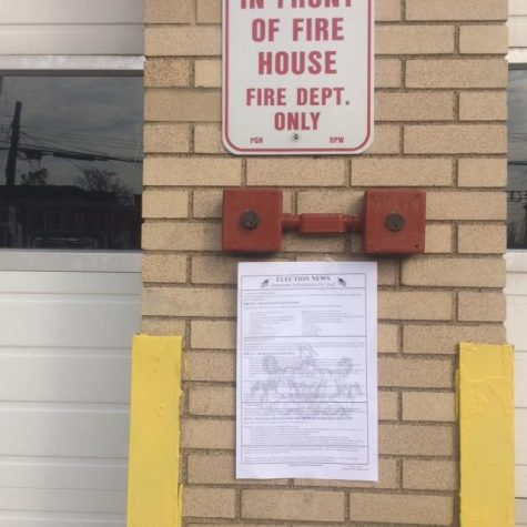 A sign outside the Pittsburgh Bureau of Fire on McKee place reminds voters entering the polling location of their rights. | Lauren Rosenblatt / News Editor