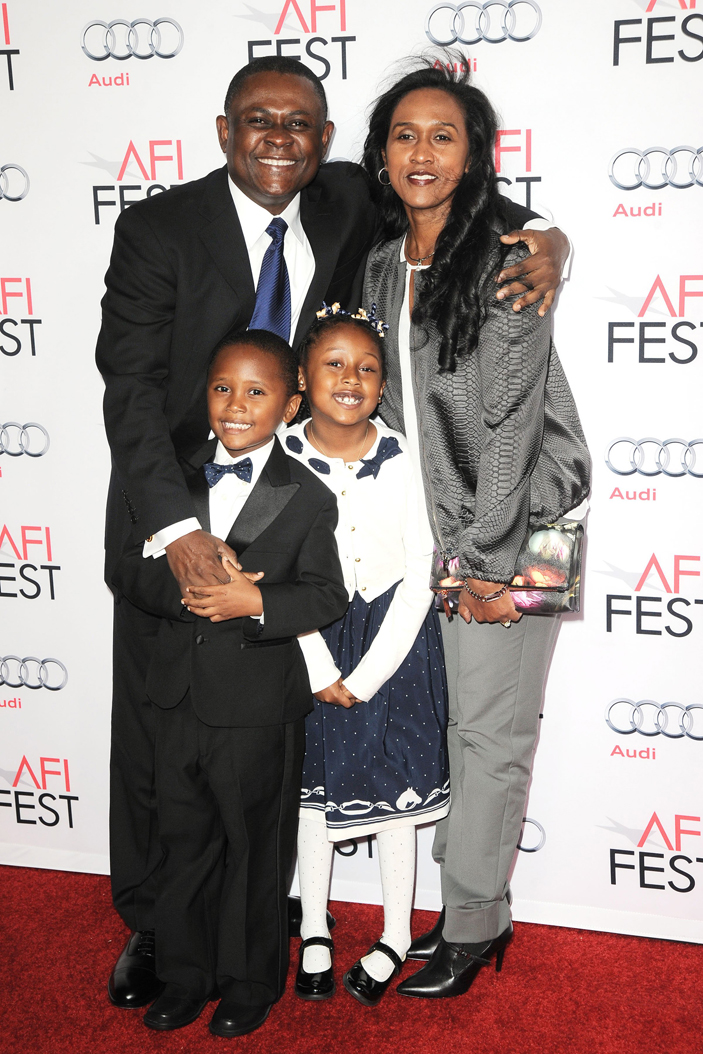 Bennet Omalu, along with his family, poses for photos on Nov. 10, 2015. TNS